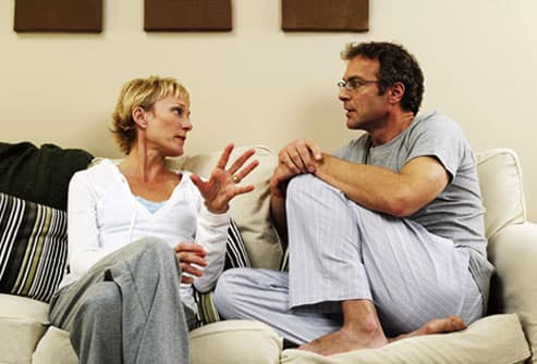 Couple having a serious discussion on their sofa