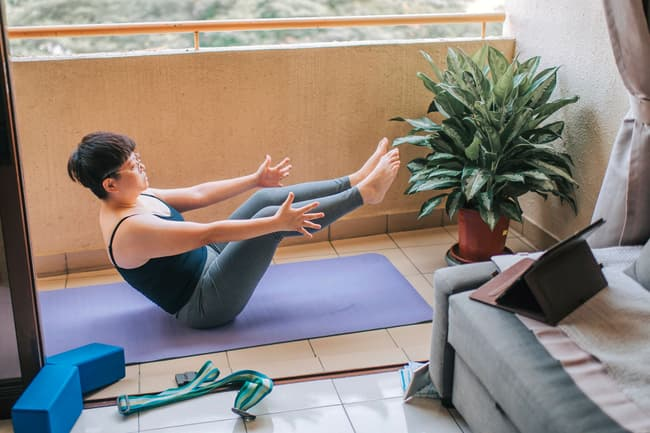 photo of woman holding pilates pose
