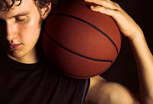 teen holding basketball