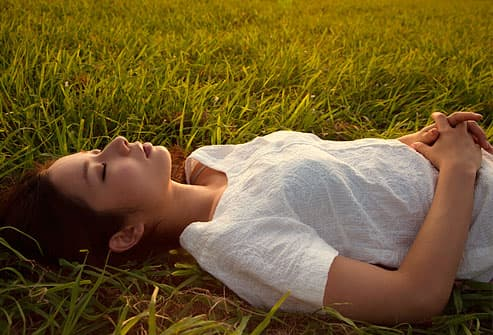 girl lying in grass