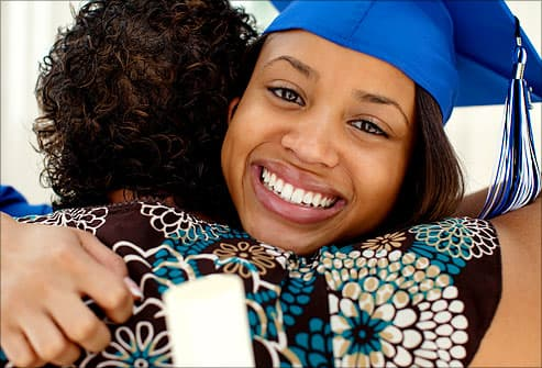 graduate embracing mother