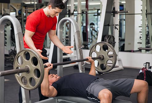 493ss_getty_rf_man_doing_bench_press