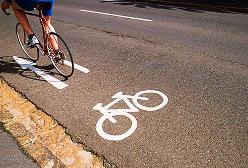 cyclist on paved bike path