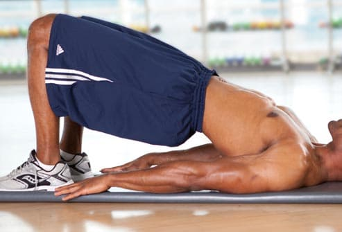 man doing glute bridge
