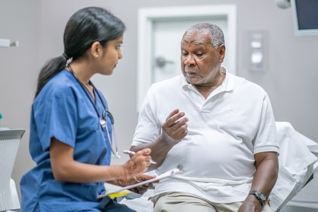 photo of mature patient talking with doctor