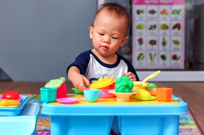 toddler playing with toys