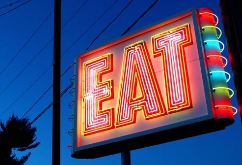 colorful neon eat sign