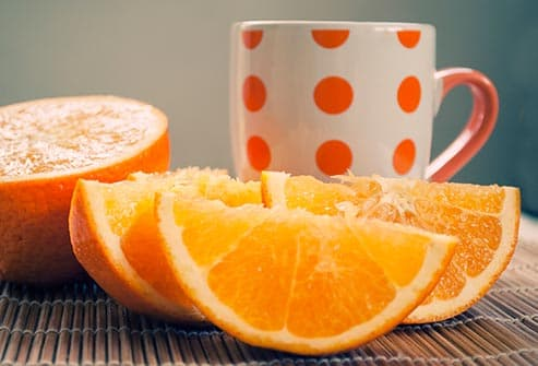 orange slices and polka dot mug