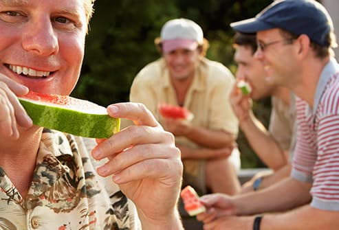 mature man eating watermelon