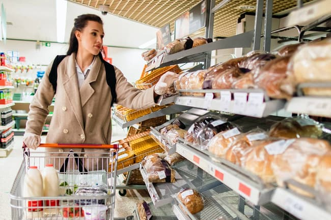 photo of woman shopping for bread