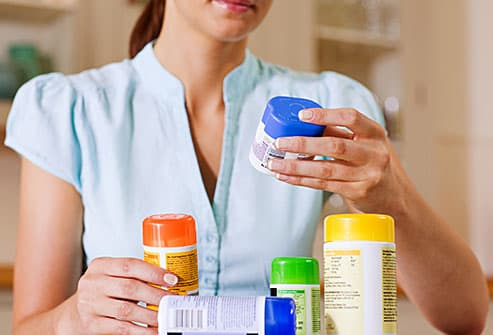 woman looking at supplements