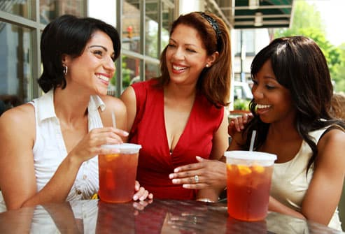 Women drinking from straws