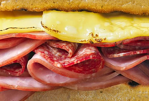 sandwich with processed meats and cheese