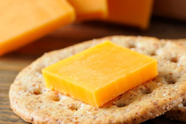 photo of cheddar cheese on cracker