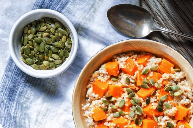 photo of oatmeal with pumpkin seeds