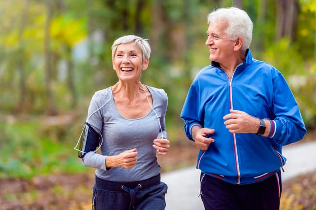 photo of mature couple jogging