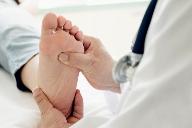 photo of doctor inspecting foot