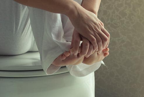 woman touching her feet