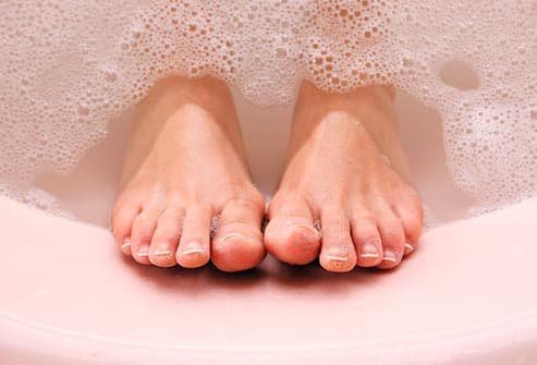 womans feet in tub