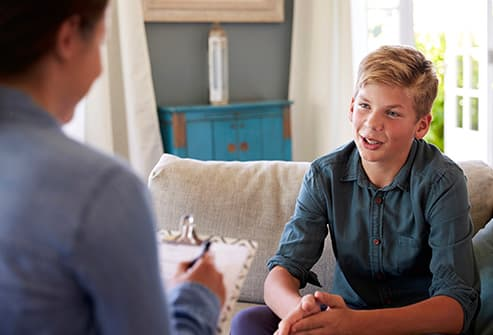 boy talking with therapist