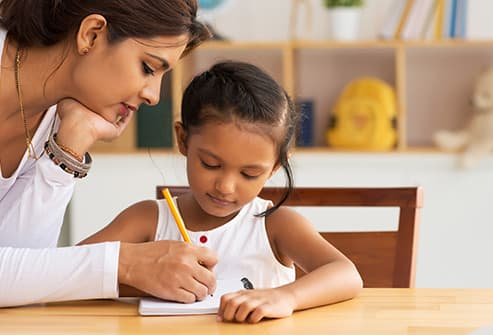 mother making list with daughter