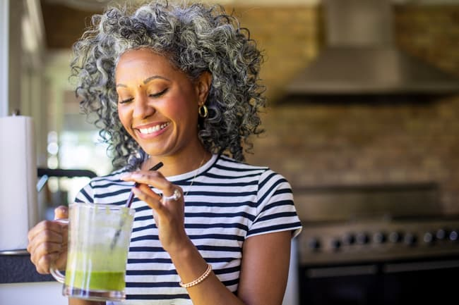 photo of woman drinking smoothie