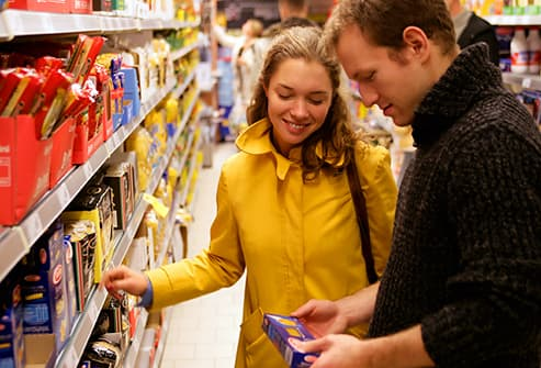 couple in reading food label in supermarket