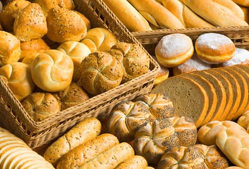 Assortment of fresh bread, rolls, buns and donuts
