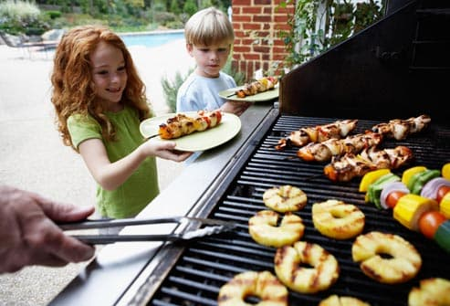 children with grilled kebabs