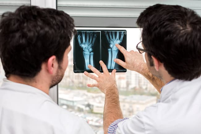 doctor and patient examining xrays