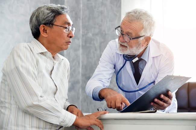 photo of doctor talking with man