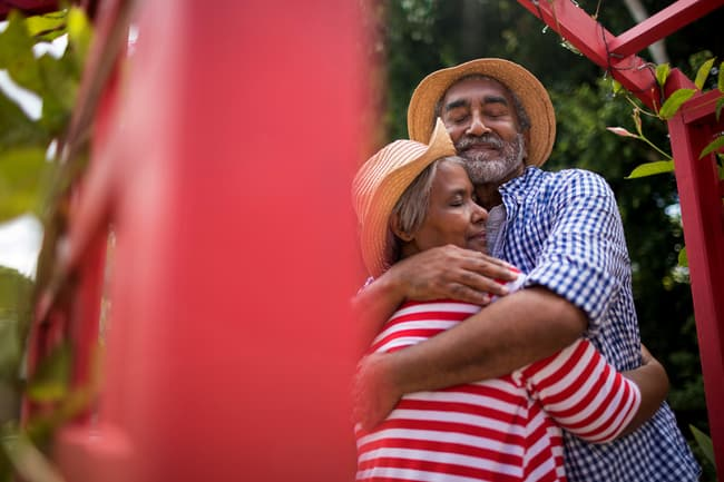 photo of mature couple hugging