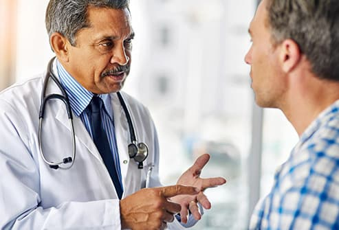 doctor speaking to male patient