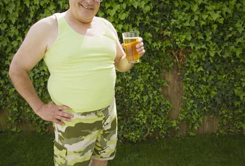 Man drinking beer in backyard