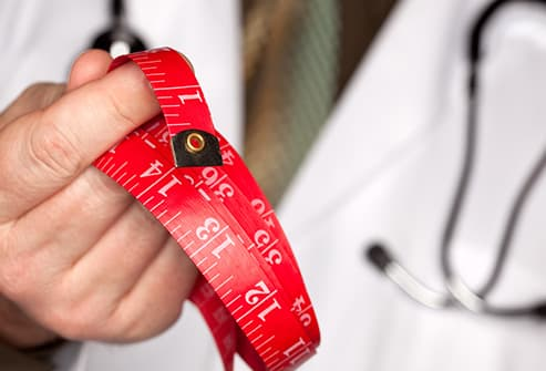 doctor holding measuring tape