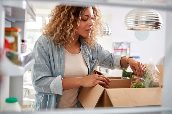 photo of woman opening grocery delivery box