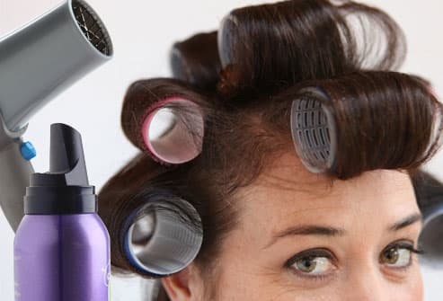 Hairdryer, mousse, and woman wearing curlers