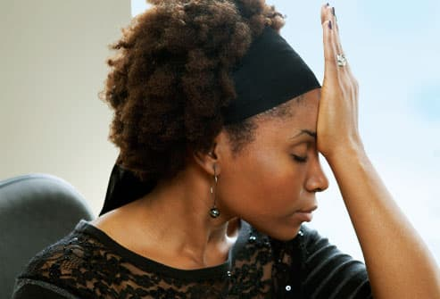 Woman doing palm to head exercise
