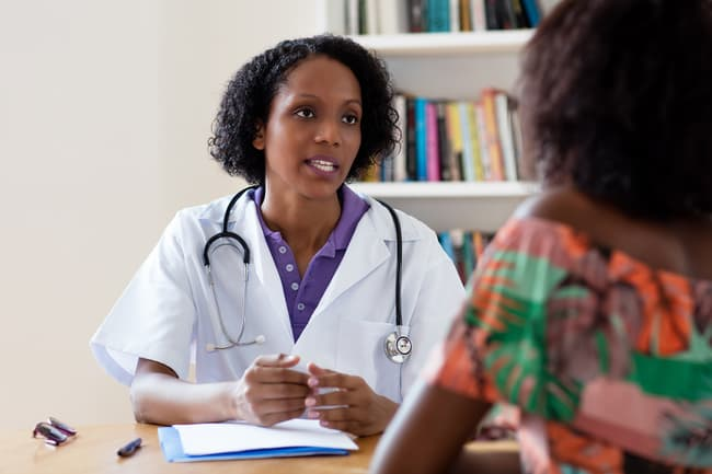 photo of doctor patient consult