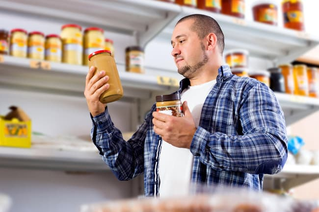 man shopping for peanut butter