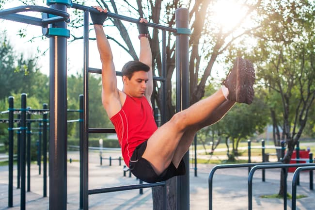 photo of man on pull up bar