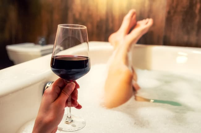 photo of drinking wine in bath