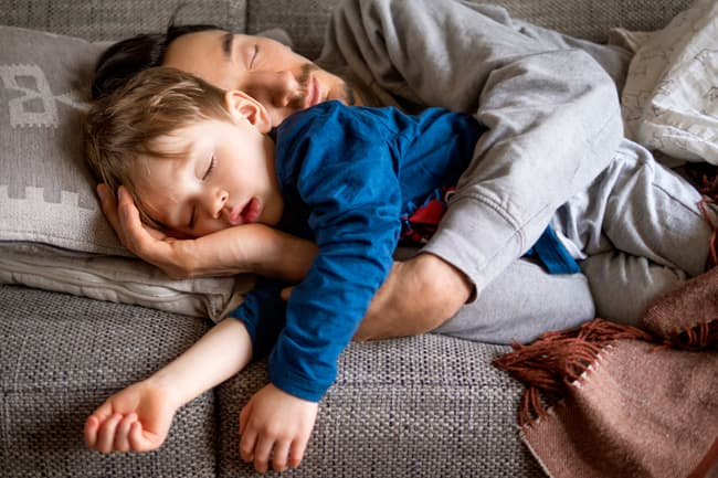 dad and son napping on couch
