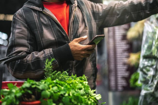photo of man shopping for greens