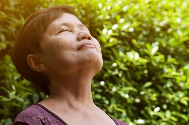 photo of mature woman breathing