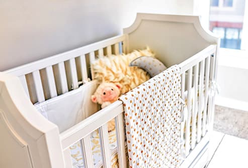 baby crib in nursery room