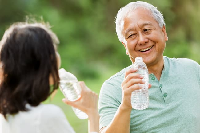 photo of mature couple with water bottles