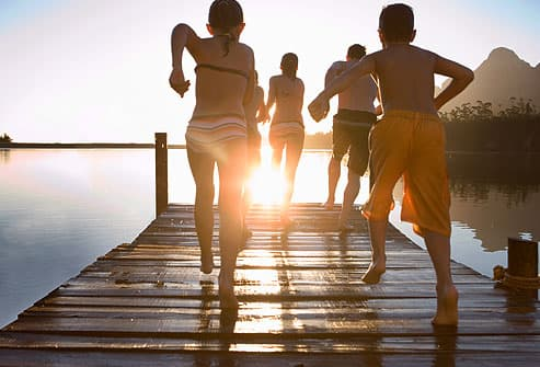 kids running on dock