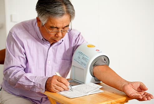man checking his blood pressure