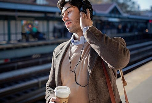 commuter listening to music